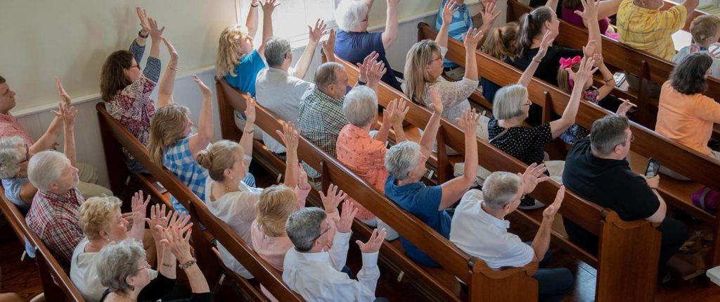 Deaf community enjoys Mass with Archbishop Lori and deaf priest