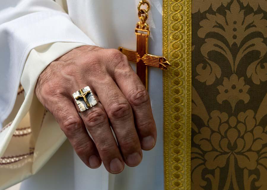 Bishop-designate Lewandowski's insignia denote his office, commitment
