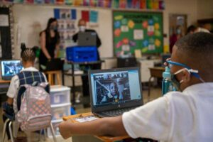 A fifth-grader at Holy Angels Catholic School connects with classmates virtually