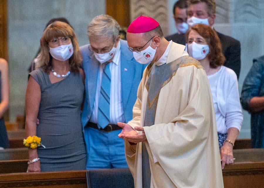 Family, friends go the distance for Bishop Lewandowski