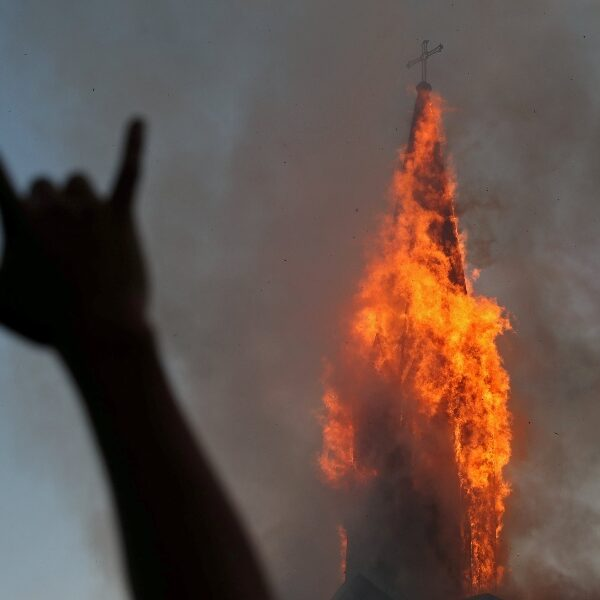 Demonstrators burn two churches in Chile on anniversary of protests