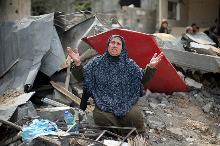 A Palestinian woman reacts after returning to her destroyed house in Gaza.