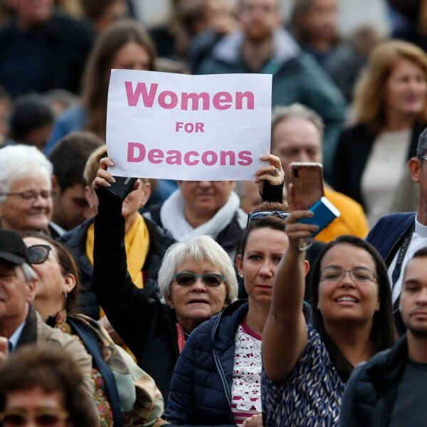 Women deacons?/Pope kissing hand